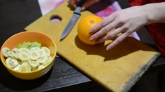 Oranges sliced ​​for fruit salad Stock Footage