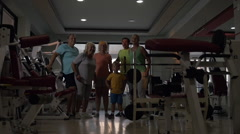 Excited sportive family in the gym - stock footage