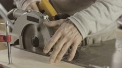 Carpenter cut wooden board on straight line. Circular saw Stock Footage