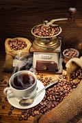 Old coffee mill and cup on wooden background Stock Photos