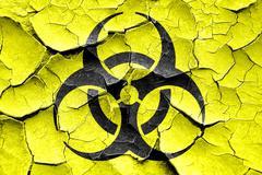 Grunge cracked Bio hazard sign on a grunge background Stock Illustration