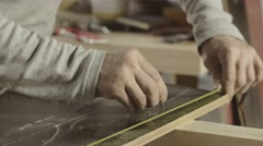 Carpenter measure wooden board by straightedge, make mark by nail. Furniture Stock Footage