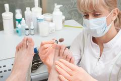 Pedicure in a Day Spa, feet nails - stock photo