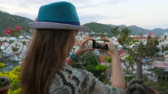 Tourist taking photograph of bonsai and backgorund in asia resort landscape - stock footage
