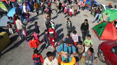 Stock Video Footage of Refugees, Lesvos, Greece. November 2015. Clowns performs for refugees.