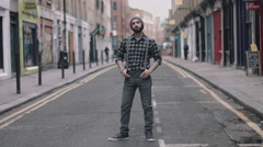 Hipster Male dancing in street looking to camera, London, England Stock Footage