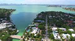Aerial drone video flying past waterfront homes in Miami Beach Stock Footage