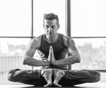 Athletic muscular young man working out, yoga - stock photo