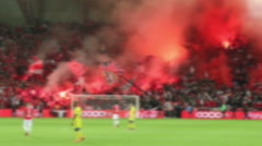 Sport. Stadium. Crowd fans lit flares at the trebune during a football match. Stock Footage