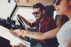 Young couple on road trip - stock photo