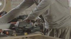 Stock Video Footage of Professional carpenter adjusts special plunge router by wrench. Furniture