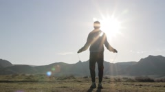 Man jumps through the rope against the background of sunlight Stock Footage