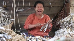 Woman sell dry seafood and products on the street food market, Burma Stock Footage