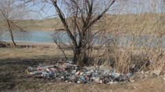 Violation of environmental, garbage thrown by people killing nature Stock Footage