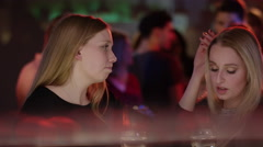 sad girl at bar in club is comforted by a friend - stock footage