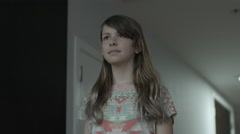 A preteen girl walking through a hallway, shot in slow motion, 120 FPS Stock Footage
