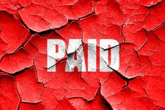 Grunge cracked paid sign background Stock Illustration
