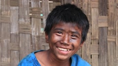 Portrait of a grimy boy working in the street garage. Myanmar, Burma Stock Footage