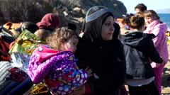Refugees, Lesvos, Greece. November 2015. The people on the shore - stock footage