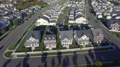 An aerial establishing shot of a suburban neighborhood, 4K UHD Stock Footage