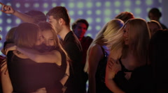 Young girls at club hugging and celebrating Stock Footage