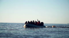 "Lesvos, Greece. November 2015. Refugees in the boat shout ""Allah Akbar!"" - stock footage"