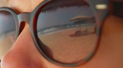 Beautiful view of summer beach reflecting in sunglasses wearing by woman Stock Footage
