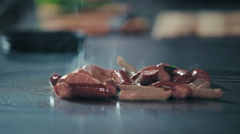 Frankfurters frying on the stove - stock footage