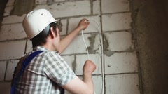 The electrician installs the wiring Stock Footage