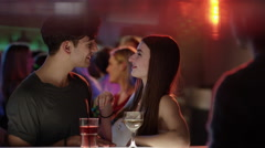 attractive girl flirting with guy at bar in club - stock footage