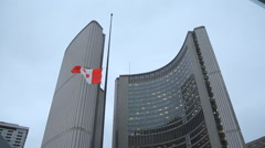 City Hall in Toronto, Ontario, Canada. Flag flying at half mast. - stock footage
