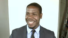 Black businessman laughing, smiling, acting silly and smug - stock footage