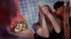 Attractive girls on dacefloor at club flirting with dj Stock Footage