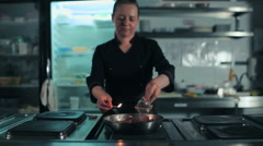 Chef doing flambe with sausage Stock Footage