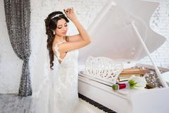 Rich Bride with beautiful eyes in the apartment - stock photo