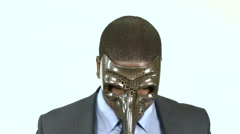Black businessman with long nosed masquerade mask (2) - stock footage