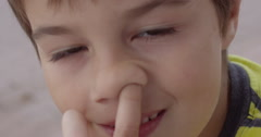 Slow Motion Boy Picking His Nose Stock Footage