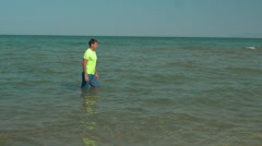 Man having run training in the water Stock Footage