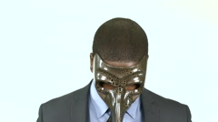 Black businessman with long nosed masquerade mask (3) - stock footage