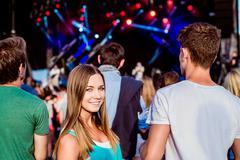 Teenagers at summer music festival having fun - stock photo