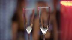 Champaign filling into glases at bar with girls in backround Stock Footage