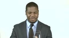 Black businessman drinking wine (3) Tasting, drunk - stock footage