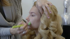 Make-up artist doing make-up model - stock footage