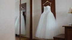 Fluffy wedding dress on a hanger - stock footage