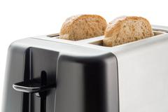 Toaster with bread slices - stock photo