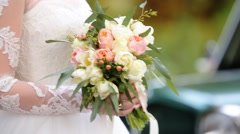 Young cute smiling bride with blue eyes holding a bouquet of flowers in her - stock footage