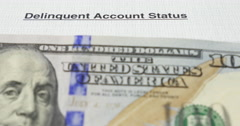 Deliquent account notice and hundred dollar bills Stock Footage