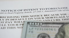 Foreclosure notice and hundred dollar bills - stock footage