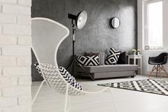 Trendy monochromatic grey living room - stock photo