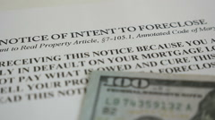 Stock Video Footage of Foreclosure notice with hundred dollar bills
